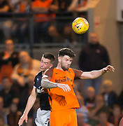 August 9th 2017, Dens Park, Dundee, Scotland; Scottish League Cup Second Round; Dundee versus Dundee United; Dundee United's Mark Durnan and Dundee's Cammy Kerr compete in the air