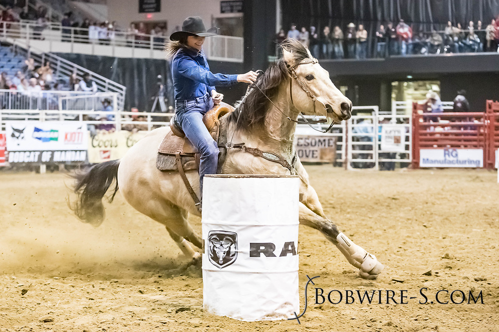 Kristi Steffes makes her barrel run at the Bismarck Rodeo on Friday, Feb. 2, 2018. She ran a 14.00.