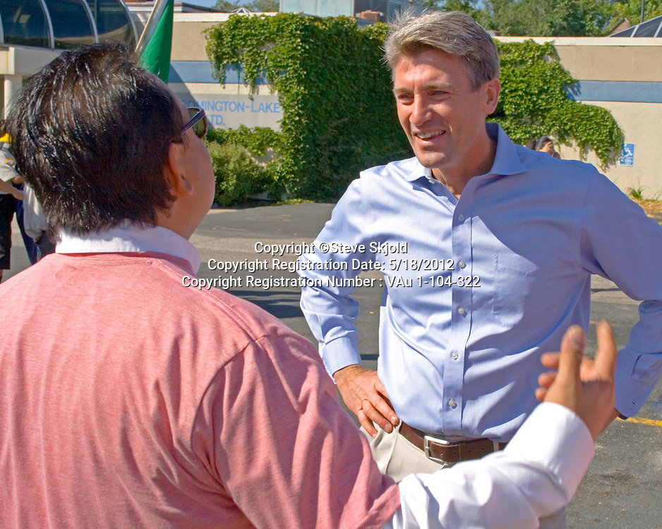 Minneapolis Mayor R. T. Rybak speaking to one of the leaders. Mexican Independence Day Minneapolis Minnesota MN USA