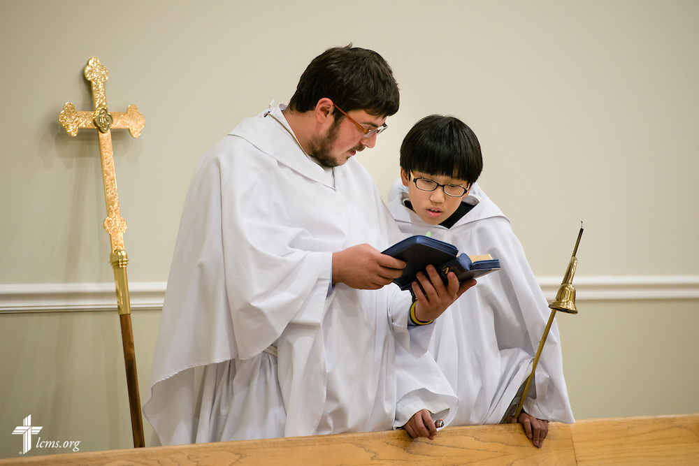 Austin Sanders and Samuel Kim share a hymnal before the procession in Divine Service on Sunday, Nov. 23, 2014, at Living Faith Korean Lutheran Church in Cumming, Ga. LCMS Communications/Erik M. Lunsford