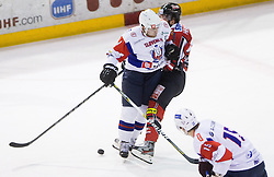 Mitja Robar of Slovenia vs Raphael Herburger of Austria during Friendly Ice-hockey match between National teams of Slovenia and Austria on April 19, 2013 in Ice Arena Tabor, Maribor, Slovenia. (Photo By Vid Ponikvar / Sportida)
