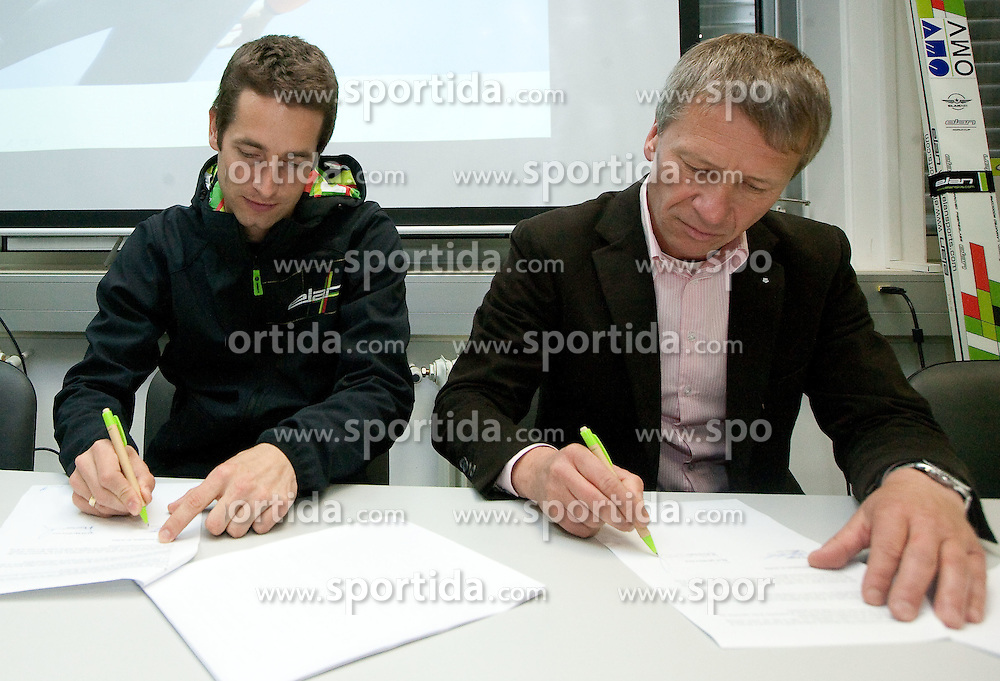 Austrian Ski Jumper Wolfgang Loitzl and General Manager of ELAN dr. Robert Ferko at press conference when Loitzl signs a contract for new season 2010/2011 with Elan on October 26, 2010 in Elan factory, Begunje, Slovenia. (Photo by Vid Ponikvar / Sportida)