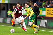 Norwich City defender Sam Byram (3) challenged by the opponent during the The FA Cup match between Burnley and Norwich City at Turf Moor, Burnley, England on 25 January 2020.
