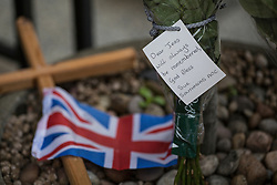 © licensed to London News Pictures. London, UK 13/12/2012. Flowers left outside King Edward VII hospital for Jacintha Saldanha, the nurse who apparently took her own life after being duped by two Australian DJ hoax callers. Photo credit: Tolga Akmen/LNP