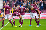 Ryotaro Meshino (#77) of Heart of Midlothian FC bows to Sean Clare (#8) of Heart of Midlothian FC after scoring the opening goal during the Ladbrokes Scottish Premiership match between Heart of Midlothian and Rangers FC at Tynecastle Park, Edinburgh, Scotland on 20 October 2019.