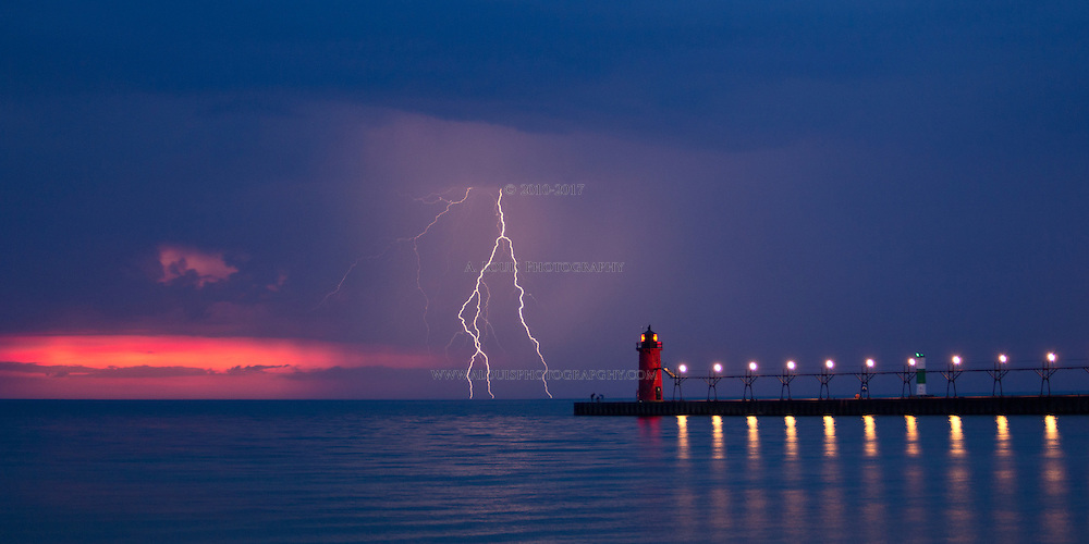 "After watching a partial solar eclipse set on Lake Michigan on May 20,2012,  This awesome lightning storm gave me several opportunities to catch lightning strikes over South Beach pier, in South Haven Michigan. This image is natively a 10x20"" panoramic print and is recommended for metallic paper."