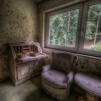 Old very moldy hotel.Hotel Schimmelig. Interior with chair and desk