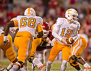 Nov 12, 2011; Fayetteville, AR, USA;  Tennessee Volunteers quarterback Matt Simms (12) looks to hand off the ball as offensive linemen Marcus Jackson (68) blocks during a game against the Arkansas Razorbacks at Donald W. Reynolds Razorback Stadium. Arkansas defeated Tennessee 49-7. Mandatory Credit: Beth Hall-US PRESSWIRE