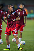 Dannie Bulman (Capt) (Crawley Town)  concerned about the direction of the ball after he kicked it into the stand while warming up prior to the EFL Cup match between Crawley Town and Norwich City at The People's Pension Stadium, Crawley, England on 27 August 2019.
