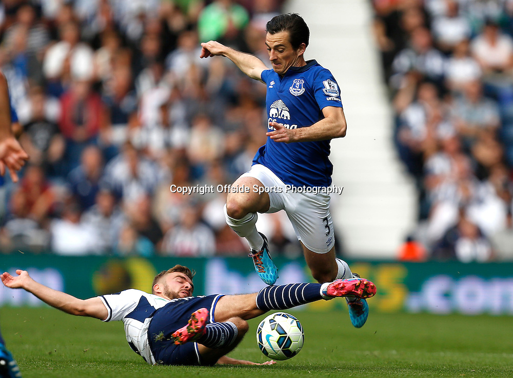 13th September 2014 - Barclays Premier League - West Bromwich Albion v Everton - Leighton Baines of Everton leaps the challenge of James Morrison of West Bromwich Albion - Photo: Paul Roberts / Offside.