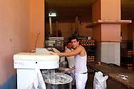 Men working in a bakery in Alquizar, Artemisa, Cuba.