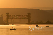 Fishing boats on the Snake River at sunrise.