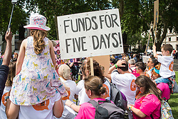 London, UK. 5 July, 2019. Hundreds of parents and children listen to a speech by Jess Phillips, Labour MP for Birmingham Yardley, at a protest organised by the Save Our Schools campaign group in Parliament Square against schools being forced to close early on Fridays due to funding cuts. The school attended by Ms Phillips's children will be closing at lunchtime on Fridays from September. Parents marched from Parliament Square to Downing Street to highlight the government's responsibility to care for and educate the nation's children on a Friday afternoon.