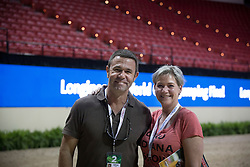 Inge Van der Net and  Guilherme Jorge in the arena of the Thomas & Mack Center<br /> FEI World Cup™ 2015 Finals - Las Vegas 2015<br />  © Hippo Foto - Dirk Caremans