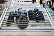Olympus advertisement on the stairs at the Javitz Center during the PDN Photo Expo Plus