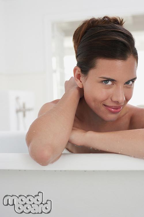Woman relaxing in bathtub portrait