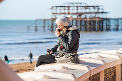 © Licensed to London News Pictures. 18/01/2020. Brighton, UK. Members of the public take advantage of the sunny and milder weather and head out the beach in Brighton and Hove. Photo credit: Hugo Michiels/LNP