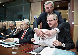 Olli Rehn, The EU's economic and monetary affairs commissioner, right, shows a chart projecting Greece's deficit declining over the next four years, as Jean-Claude Juncker, Luxembourg's prime minister jokes around and tries to cover it up, during an emergency meeting of euro zone finance ministers in Brussels, on Sunday, May 2, 2010. Greece accepted an unprecedented bailout from the European Union and International Monetary Fund worth more than 110 billion euros ($146 billion). (Photo © Jock Fistick)