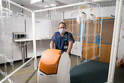 Paul Yee poses for a portrait with the NAME UV Disinfection Robot at Gillette Children's Specialty Healthcare in Saint Paul, Minnesota on Wednesday, June 24, 2020.
