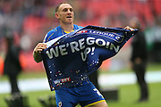 AFC Wimbledon defender Barry Fuller (2) with a 'we're going up' banner during the Sky Bet League 2 play off final match between AFC Wimbledon and Plymouth Argyle at Wembley Stadium, London, England on 30 May 2016.