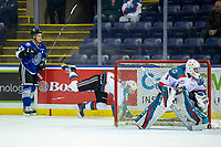 KELOWNA, CANADA - AUGUST 31:  Dino Kambeitz #25 of the Victoria Royals checks Libor Zabransky #7 behind the net of James Porter #1 of the Kelowna Rockets  on August 31, 2018 at Prospera Place in Kelowna, British Columbia, Canada.  (Photo by Marissa Baecker/Shoot the Breeze)  *** Local Caption ***