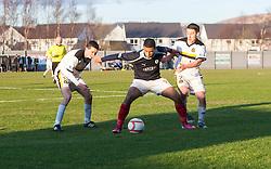 Dumbarton's PaulMcGinn, Falkirk's Lyle Taylor and Dumbarton's Mark Gilhaney..Dumbarton 0 v 2 Falkirk, 23/2/2013..©Michael Schofield.