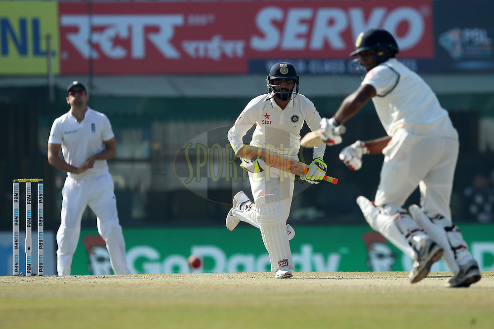 Ravindra Jadeja and Jayant Yadav of India running between the wicket during day 3 of the third test match between India and England held at the Punjab Cricket Association IS Bindra Stadium, Mohali on the 28th November 2016.Photo by: Prashant Bhoot/ BCCI/ SPORTZPICS