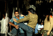 The leading man in a film production performs a fight scene on the set of an action movie in film city in the outskirts of Bombay, India Dec. 7, 2004.Bombay's film industry may be the most prolific in the world, but unlike it's American counterpart, much of the work is done on a shoestring. The city churns out hundreds of films a year on its celluloid production line.