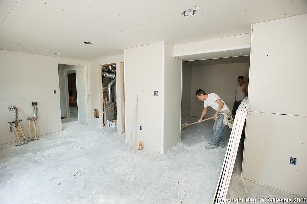 Contractors work on remodeling the Barry home. The Barry family, residing in the Four Seasons development near Gambrills in the western part of Anne Arundel County, has been selected as the second recipient of the MARYLAND HOME MAKEOVERª.  (Photo by Paul W Gillespie) 7/30/10