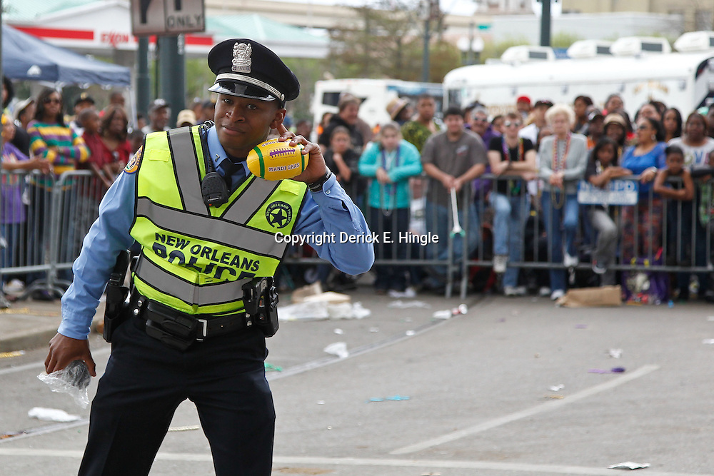 February 21, 2012; New Orleans, LA, USA; A member of N.O.P.D. teases revelers screaming for coconuts and other throws as the Krewe of Zulu parade rolled along the uptown New Orleans St. Charles Avenue parade route throwing beads, painted coconuts and various trinkets on Mardi Gras day. Mardi Gras is an annual celebration that ends at midnight with the start of the Catholic Lenten season which begins with Ash Wednesday and ends with Easter. Photo by: Derick E. Hingle