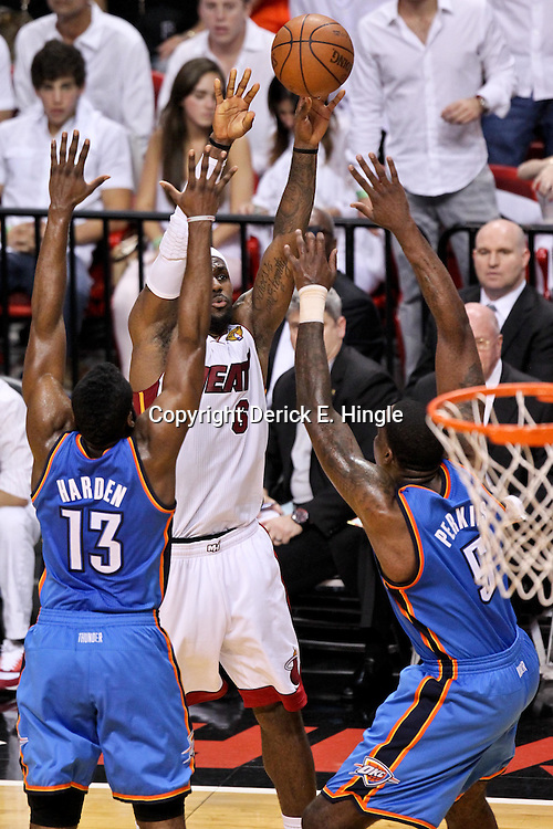 Jun 21, 2012; Miami, FL, USA; Miami Heat small forward LeBron James (6) shoots over Oklahoma City Thunder guard James Harden (13) and power forward Serge Ibaka (9) during the second quarter in game five in the 2012 NBA Finals at the American Airlines Arena. Mandatory Credit: Derick E. Hingle-US PRESSWIRE