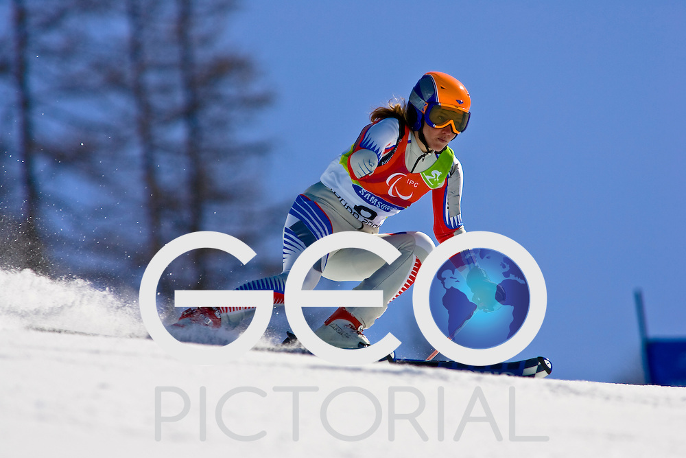 SESTRIERE COLLE, ITALY - MARCH  16th : Evgenia Ponomareva (LW6/8-2) of Russia on her second run of the Womens Alpine Skiing Giant Slalom Standing competition on Day 6 of the 2006 Turin Winter Paralympic Games on March 16th, 2006 in Sestriere Borgata, Italy.