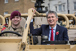 © Licensed to London News Pictures. 26/10/2013. Horseguards, London. Secretary of State Rt Hon Philip Hammond attends an Army Reserve recruiting event today  in central London today.  The Army Reserve who are aiming to boost their numbers to 30,000 by the end of 2018.   Photo credit: Alison Baskerville/LNP