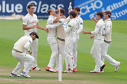 Tom Curran of Surrey celebrates with Jason Roy of Surrey as he catches out Benny Howell of Gloucestershire for three  - Mandatory byline: Dougie Allward/JMP - 07966386802 - 21/08/2015 - Cricket - County Ground -Bristol,England - Gloucestershire CCC v Surrey CCC - LV= COUNTY CHAMPIONSHIP