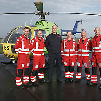 FREE TO USE PHOTOGRAPH....30.10.15<br /> Scotland's Charity Air Ambulance (SCAA) unveiled it's new helicopter at Perth airport this morning a EC135 T2i (pictured) which replaces the Bolkow 105 helicopter which is retiring from service. The new helicopter will increase speed, range, endurance and payload, allow SCAA to fly at night and in cloud. The Paramedic team from left, Mark Tynan, Craig McDonald, Chief Pilot Russell Myles, Julia Barnes, John Salmond and Lead Paramedic John Pritchard.<br /> for further info please contact Maureen Young on 07778 779000<br /> Picture by Graeme Hart.<br /> Copyright Perthshire Picture Agency<br /> Tel: 01738 623350  Mobile: 07990 594431