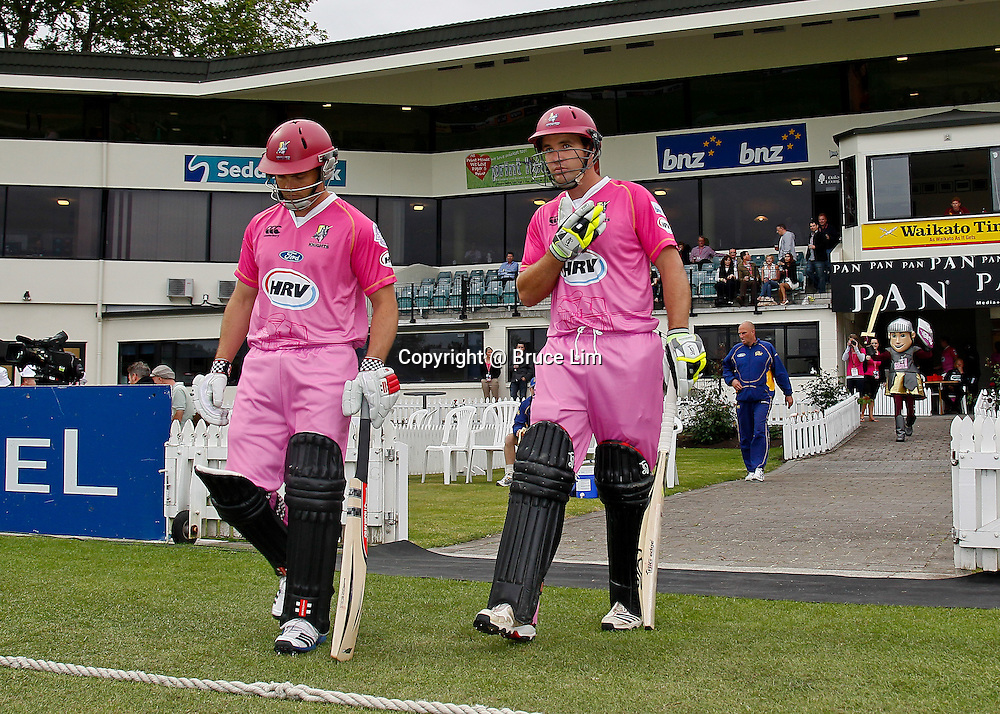 Northern Districts openers Daniel Flynn (left) and Brad Wilson (right) walk out to bat during the HRV Cup - Northern Knights v Otago Volts, 2 November 2012.  Photo:  Bruce Lim / photosport.co.nz