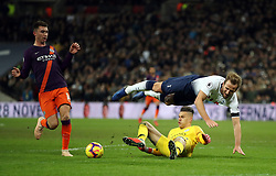 """Tottenham Hotspur's Harry Kane goes to ground from a challenge by Manchester City goalkeeper Ederson during the Premier League match at Wembley Stadium, London. PRESS ASSOCIATION Photo. Picture date: Monday October 29, 2018. See PA story SOCCER Tottenham. Photo credit should read: Nick Potts/PA Wire. RESTRICTIONS: EDITORIAL USE ONLY No use with unauthorised audio, video, data, fixture lists, club/league logos or """"live"""" services. Online in-match use limited to 120 images, no video emulation. No use in betting, games or single club/league/player publications."""