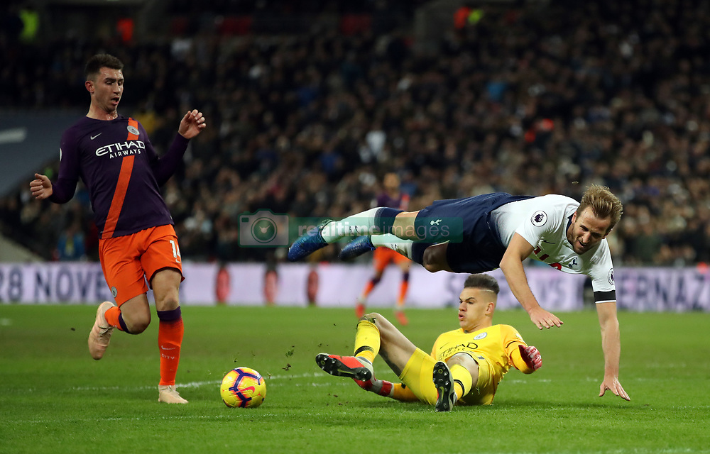 "Tottenham Hotspur's Harry Kane goes to ground from a challenge by Manchester City goalkeeper Ederson during the Premier League match at Wembley Stadium, London. PRESS ASSOCIATION Photo. Picture date: Monday October 29, 2018. See PA story SOCCER Tottenham. Photo credit should read: Nick Potts/PA Wire. RESTRICTIONS: EDITORIAL USE ONLY No use with unauthorised audio, video, data, fixture lists, club/league logos or ""live"" services. Online in-match use limited to 120 images, no video emulation. No use in betting, games or single club/league/player publications."