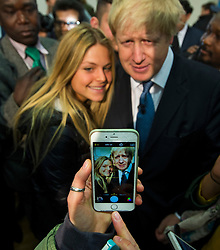 © London News Pictures. 01/04/2015. Mayor of London BORIS JOHNSON poses for a selfie in Mill Hill, North London to officially launch the Conservative 2015 election campaign. Boris Johnson is Photo credit: Ben Cawthra/LNP