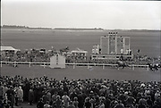 """26/06/1965<br /> 06/26/1965<br /> 26 June 1965<br /> Irish Sweeps Derby at the Curragh Race Course, Co. Kildare. View from the stand  as """"Meadow Court"""" approaches the finish line with """"Convamore"""" in pursuit."""