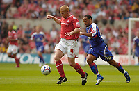 Photo: Leigh Quinnell.<br /> Nottingham Forest v Carlisle United. Coca Cola League 1. 16/09/2006. Forests Gary Holt gets away from Carlises Karl Hawley.