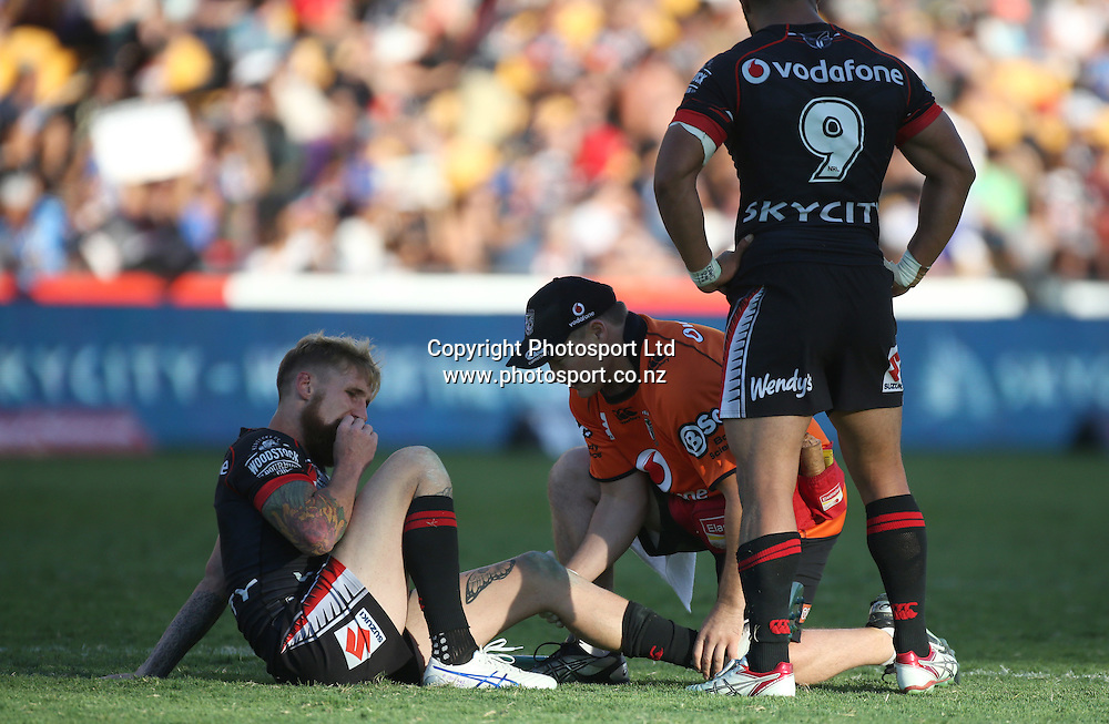 Warriors fullback Sam Tomkins is treated for an injury of the field during the NRL Rugby League match between the NZ Warriors and the Parramatta Eels played at Mt Smart Stadium in South Auckland on the 21st March 2015. <br /> <br /> Copyright Photo; Peter Meecham/ www.photosport.co.nz