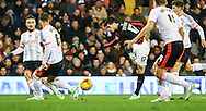 Joao Carlos of Brighton and Hove Albion (3rd left) shoots during the Sky Bet Championship match at Craven Cottage, London<br /> Picture by David Horn/Focus Images Ltd +44 7545 970036<br /> 29/12/2014
