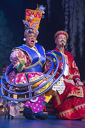 "© Licensed to London News Pictures. 05/12/2013. London, England. Picture: Matthew Kelly as Widow Twankey and John Conroy as Emperor. The Panto Aladdin starring Jo Brand as the Genie of the Ring and Matthew Kelly as Widow Twankey opens at the New Wimbledon Theatre, Wimbledon, London. From 6 December 2013 to 10 January 2014. Further actors: the dance group ""Flawless"" as the Peking Police Force, Oliver Thornton as Aladdin, David Bedella as Abanazar, Claire-Marie Hall as Princess Jasmine. Photo credit: Bettina Strenske/LNP"