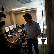 "August 29, 2014 - New York, NY : News Anchor David Muir, right, speaks with Anchor Producer Christine Romo, left, after reviewing footage from a shoot Muir did along the Syrian border, at ABC News on West 66th Street on Friday afternoon. Editor Martin Bauza is visible in the background. David Muir is taking over for Diane Sawyer as anchor of ABC's ""World News Tonight."" CREDIT: Karsten Moran for The New York Times"