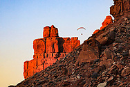 A Visitor flies a motorized parachute in a scenic area outside of Monument Valley.
