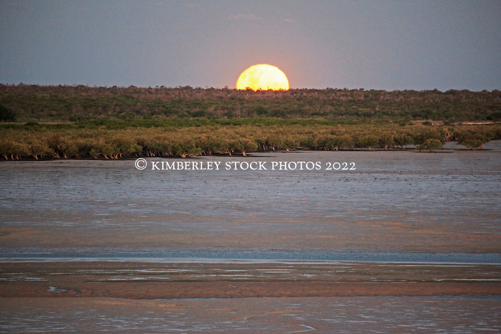 The full moon rises over Roebuck Bay.