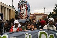 Roma 17 Ottobre 2009.Manifestazione nazionale contro il razzismo e discriminazioni e violazione dei diritti umani.October 17, 2009.National demonstration against racism and discrimination and violation of human rights.Banner reads in French 'Without paper' (up) and in Italian 'Protector of the world's migrants'