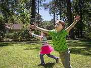 Samuel and Eleanor (Me Me) chase bubbles at their Bluffton home.