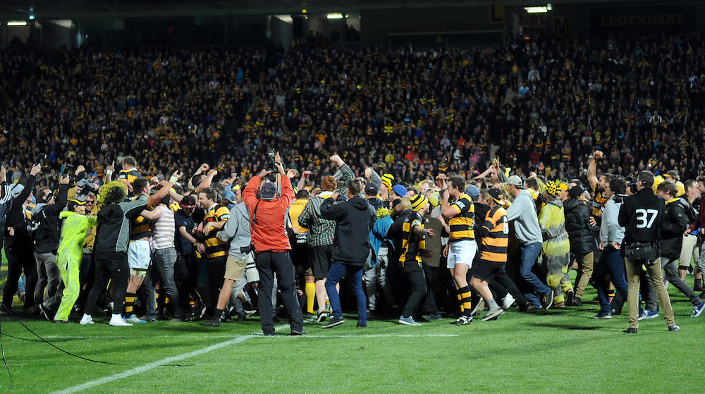 Fans invade the pitch following the win by Taranaki over the Tasman Makos in the ITM Cup Rugby Premiership final match at Yarrow Stadium, New Plymouth, New Zealand, Saturday, October 25, 2014. Credit:SNPA / Ross Setford